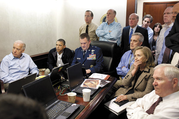 Secretary of State Hillary Rodham Clinton, President Barack Obama and Vice President Joe Biden, along with with members of the national security team, receive an update on the mission against Osama bin Laden in the Situation Room of the White House, Sunday, May 1, 2011, in Washington.