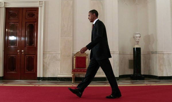 President Barack Obama walks down the Cross Hall on the way to the East Room to make a televised statement on the death of Osama bin Laden from the White House in Washington, Sunday, May 1, 2011.