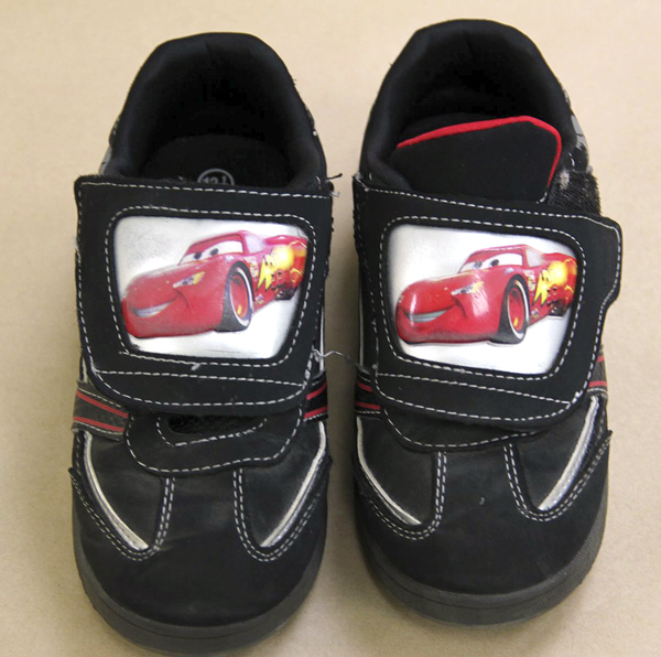 "A photo released by the Maine State Police  shows ""Lightning McQueen"" black sneakers worn by a young boy found dead along a remote road in South Berwick, Maine, Saturday afternoon"