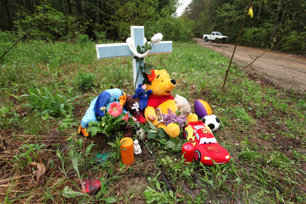 A memorial is seen Tuesday in South Berwick, Maine near where the body of an unidentified boy was found  Saturday. Police have classified the death as suspicious.