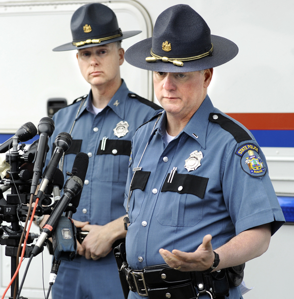 Maine state police Col. Robert Williams, left, and Lt. Bryan McDonough appear at a news conference Monday outside a state police mobile command post in South Berwick, Maine to update the media on the death of a young boy found along the road Saturday.