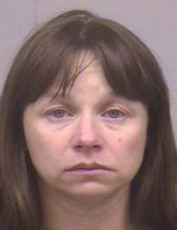 This 2005 booking photo provided by the Dallas County Jail shows Julianne McCrery of Irving, Texas. A pickup truck registered to McCrery was towed from a rest stop in Chelmsford, Mass., where earlier police took a woman for questioning in the investigation of a boy whose body was found along a dirt road in Maine last weekend.