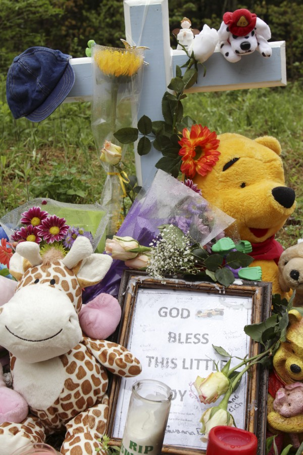 A memorial site is seen near the spot where Camden Pierce Hughes' body was found last Saturday in South Berwick, Maine.
