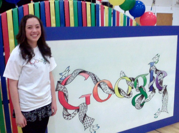 Brewer High School freshman Morgan Forrest, 15, stands beside her design for the Doodle 4 Google contest after officials announced at a school assembly that she is one of 40 finalists. More than 107,000 art students from all over the United States submitted designs, officials from Google announced. Folks that want to vote for her design can go to google.com/doodle4google.