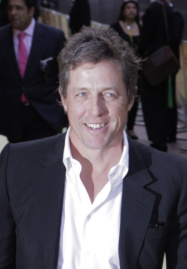 British actor Hugh Grant poses for the photographers as he arrives for the European premiere of the &quotFire in Babylon&quot film at a central London's cinema, Monday, May 9, 2011. Grant may replace Charlie Sheen in &quotTwo and a Half Men.&quot