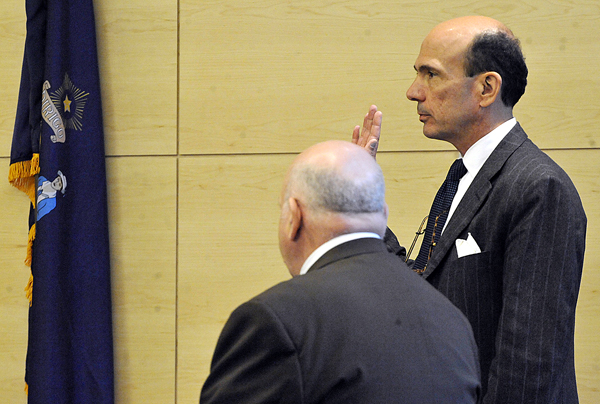 Assistant Attorney General Andrew Benson is sworn in before giving his testimony during a hearing for defendant Zachary Carr at Penobscot Judicial Center Friday.
