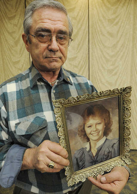 Dick Moreau holds a photograph of his daughter Kim during a press conference on Monday at the Hilton Garden Inn in Auburn. Kim Moreau was 17 when she disappeared in 1986; Moreau has not given up the search for his daughter.