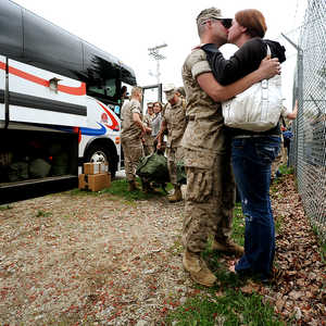 Johanna Ellis says goodbye to her fiance Sgt. Kelly Buzzell in Topsham on Thursday as Company A, 1st Battalion, 25th Marine Regiment prepared to leave for Camp Pendleton California and then Afghanistan.  Ellis and Buzzell have only been engaged for three weeks.