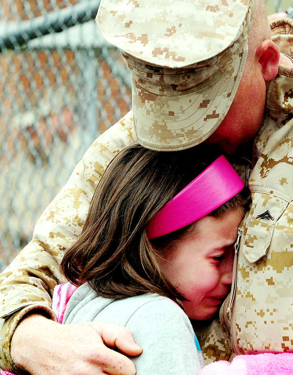 Sasha Crowley, 10, from Addison, says goodbye to her brother Lance Cpl. John Crowley as he deploys with Company A, 1st Battalion, 25th Marine Regiment from Topsham on Thursday.