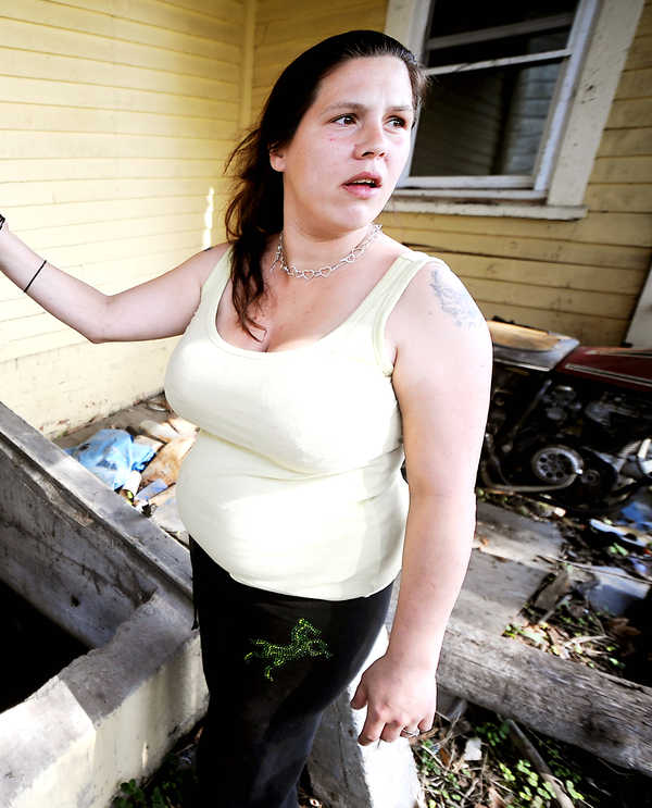 Kathleen Schidzig shows off her condemned Lewiston home in 2010.  Schidzig has been charged with criminal fraud by DHHS and is scheduled to go to trial in Androscoggin County Superior Court in May.