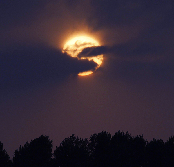 The sun sets over the horizon near Changchun in northeastern China's Jilin province, Saturday. Across the globe, followers of a California preacher's long-publicized message that Judgment Day would arrive Saturday turned to the Bible, the book they believe predicts Earth's destruction on May 21.