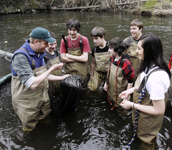 Chris Bowser of the New York State Department of Environmental Conservation (left), checks a net for American eels with Kingston High School students on the Black Creek in West Park, N.Y. Besides being a researcher in New York'??s Hudson River Estuary Program, environmental scientist Bowser leads citizen projects that collect reams of data for other scientists.