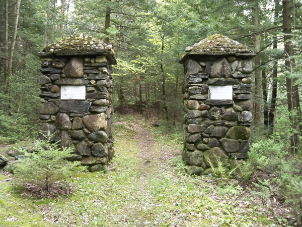 These stone towers mark the entrance to the Dartmouth trail on the campus of Good Will-Hinckley, midway between Waterville and Skowhegan on Route 201.  The towers were erected in 1915 by the Dartmouth Outing Club, using local fieldstone. A number of other historic stone monuments can be found along the forested trails of the 2,400 acre campus.