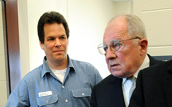 Dennis Dechaine (from left) walks out of a meeting with famed defense attorney F. Lee Bailey at the Maine State Prison in Warren in 2009.