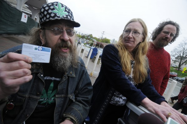 David Bunn, left, of Brownville shows his medical marijuana registration card to the media as he joined Vicki Barnard, center, of Gouldsboro, wife of Jeffrey Barnard before they entered a hearing for Barnard's husband in U.S. District Court Tuesday morning, May 17, 2011. Jeffrey Barnard, 47, of Gouldsboro made an appearance in U.S. District Court in Bangor Tuesday, May 17 hoping for leniency for repeated use of marijuana while on federal probation. He has a medical marijuana registration card so he can use marijuana to help alleviate his medical issues. Also standing next to Vicki Barnard (on right) was supporter Jeff Black, right of Mariaville.
