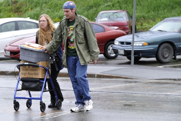 Joined by supporter Mike Noyes, right, of Cherryfield, Vicki Barnard, left, of Gouldsboro, wife of Jeffrey Barnard, carted legal documents across Harlow Street on her way to a hearing for her husband in U.S. District Court Tuesday morning, May 17, 2011. Jeffrey Barnard, 47, of Gouldsboro made an appearance in U.S. District Court in Bangor Tuesday, May 17 hoping for leniency for repeated use of marijuana while on federal probation. He has a medical marijuana registration card so he can use marijuana to help alleviate his medical issues.
