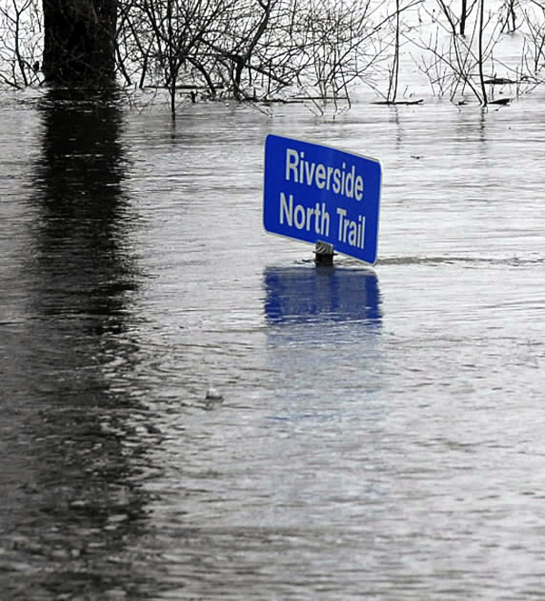 A trail sign at Fort Kent's Riverside Park is partially submerged Thursday as the St. John River approached flood stage.