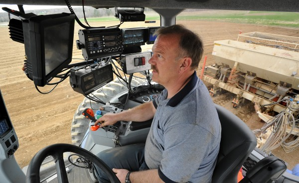 Steve Crane, co-owner of Crane Brothers Farms, plants potatoes using computerized equipment and a highly accurate GPS system in Exeter on Tuesday. They plant about 1,300 acres of potatoes, 1,100 acres of corn and 200 acres of small greens each year.