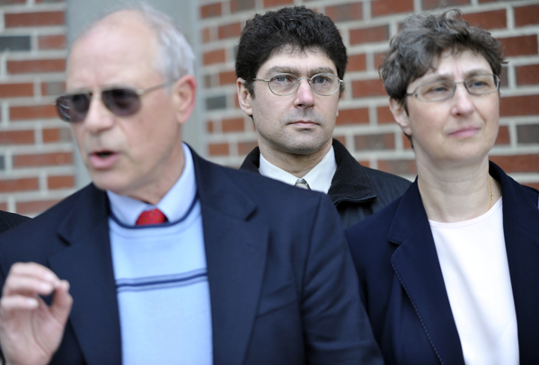 Vladek Filler (center), and his sister Tatyana Roberts, (right), listen to comments from Edward Bartlett Ph.D.(left) president of the Stop Abusive and Violent Environments, during a May 12 press conference in front of the Penobscot Judical Center.