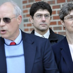 Vladek Filler, second from right, and his sister Tatyana Roberts,  right, listen to comments from Edward Bartlett Ph.D.(left) president of the Stop Abusive and Violent Environments.