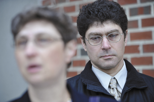 Vladek Filler (right), listens to his supportive sister Tatyana Roberts  (left), address the media during a press conference in front of the Penobscot Judical Center on May 12., 2011.