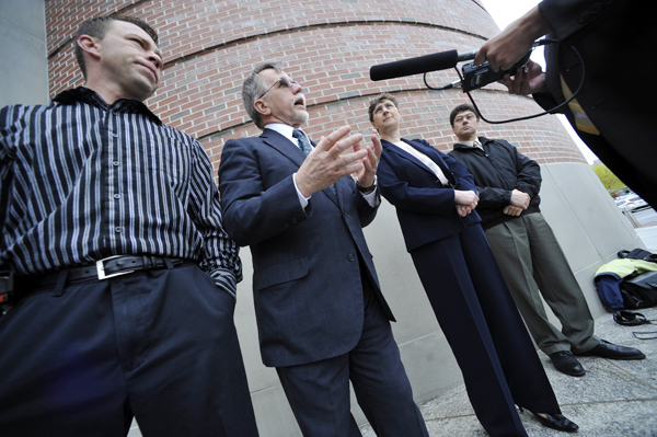 Michael Webber (far left) , of Penobscot listened to his attorney Steven Juskewitch address the media as Tatyana Roberts and her brother Vladek Filler (far right), looked on during Thursday morning's press conference in front of the Penobscot Judicial Center.  Webber and Filler say they were wrongly accused by their former spouses and were making a public appeal to ovehaul the prosecution of their's and others' cases. Filler later attended a hearing at the Penobscot Judicial Center as part of his appeal.