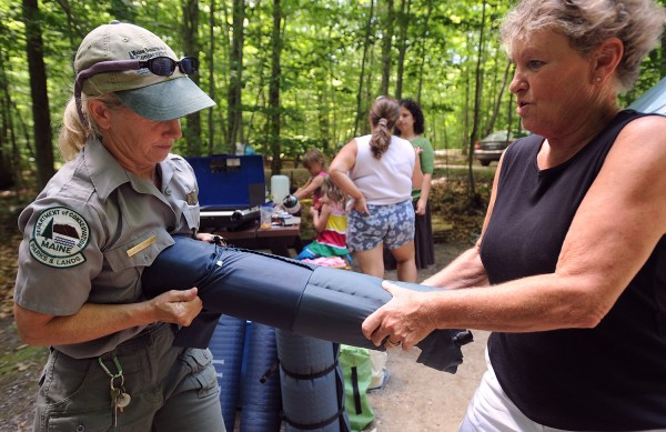 Pat Foley (right) and Ranger Sandie Sabaka take the cover off of one of the sleeping pads as they set up camp at Camden Hills State Park on Friday, July 9, 2010. Foley, her daughter, great granddaughter and her friend were among the people who won free first time camping opportunities from the state.