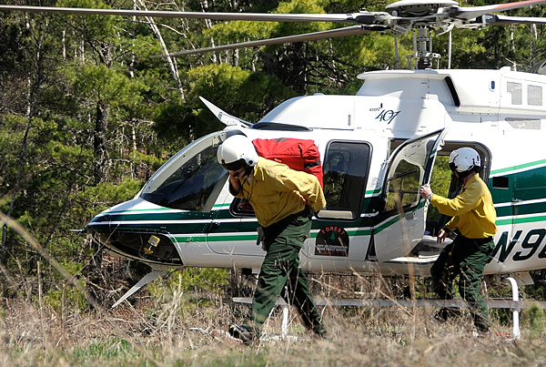 Forest rangers deploy from a Maine Forest Service Bell 407 helicopter after landing near a simulation burn site for their media demonstration in Township 32 MD Monday morning.