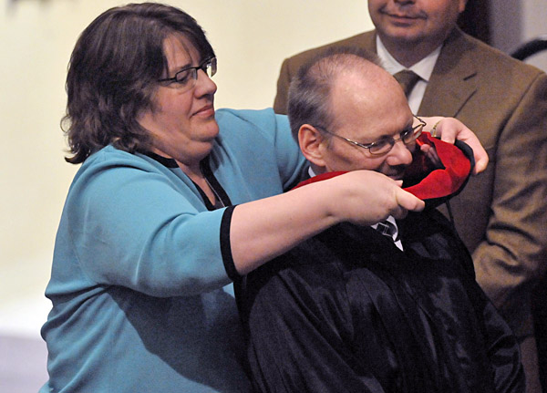 Grace Evangelical College and Seminary held its sixth commencement at the Old Town United Baptist Church on Wed., May 11, 2011. James Buhr receives his official hood signifying a Master of Divinity degree from his wife Karen.