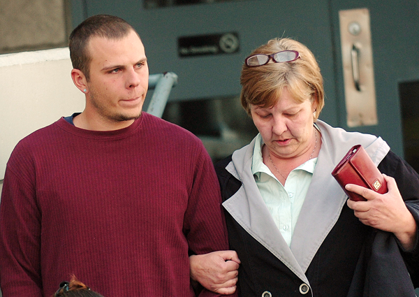 Garrett Cheney (left), of South Berwick leaves the Penobscot County Jail in April 2010 accompanied by an unidentified woman after making bail on charges related to the Jan. 30, 2010  hit-and-run death of Jordyn Bakley, 20, of Camden on Middle Street in Orono.