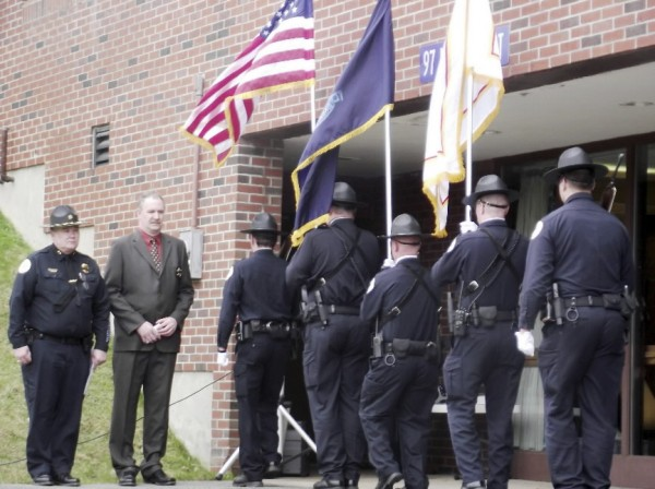 Houlton Police Chief Butch Asselin (left) and Pastor Wayne Robertson preside over a ceremony on Wednesday for fallen law enforcement officers.The event was held at the Houlton Police Department before the start of National Police Week, May 15-21.