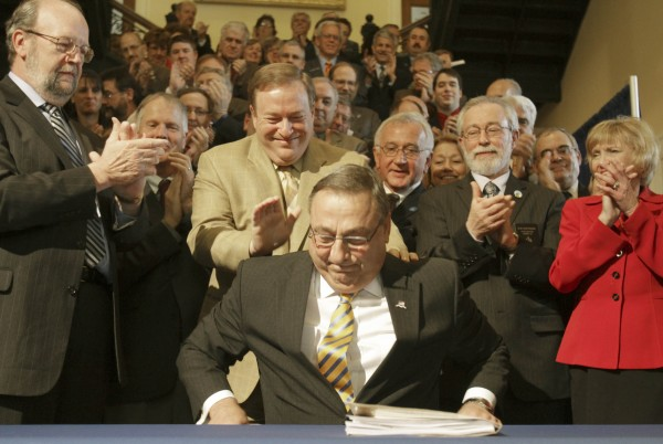 Maine Gov. Paul LePage smiles as he is congratulated after signing the health insurance overhaul bill at a State House signing ceremony in Augusta, Maine on  Tuesday, May 17, 2011. LePage is surrounded by fellow Republicans, at left is House Speaker Robert Nutting, R-Oakland and Senate President Kevin Raye, center, R-Perry.