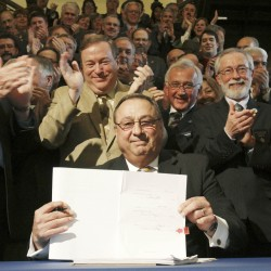 Maine Gov. Paul LePage holds up the health insurance overhaul bill that he just signed at a State House signing ceremony in Augusta, Maine on Tuesday, May 17, 2011. LePage is surrounded by fellow Republicans, at left is House Speaker Robert Nutting, R-Oakland, and Senate President Kevin Raye (center), R-Perry.