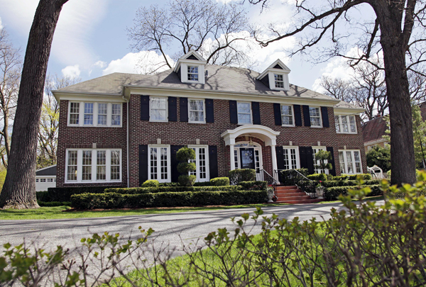 "This 14-room brick house in Winnetka, Ill., seen Friday, May 6, 2011, and featured in the 1990 movie ""Home Alone"" has been put up for sale for $2.4 million. The family comedy featured a young Macaulay Culkin defending the house from intruders. The 4,250-square foot house sits on a half-acre lot about 20 miles north of Chicago. There are four bedrooms and it features the staircase that Culkin sledded down in the movie."