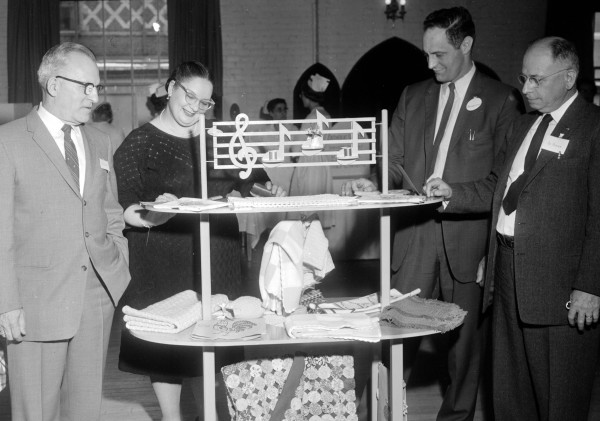 One of the attractive displays at the May 3, 1961, open house at Bangor State Hospital was the work of the occupational therapy department. Looking over the items are (from left) Walter Ulmer, business manager; Harriet Lincoln, psychologist and program director; William J. Deering, chief psychologist; and Harold A. Pooler, hospital superintendent.