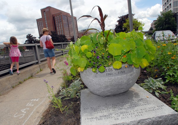 Meghan Ireland (left) and her mother, Julie Ireland of Hampden, walk past the Charlie Howard Memorial (foreground) at Kenduskeag Plaza in downtown Bangor in 2009.