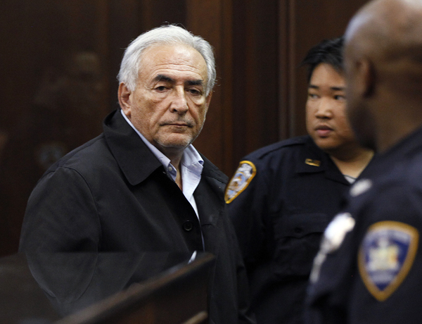 Dominique Strauss-Kahn, head of the International Monetary Fund, leaves court Monday after his arraignment  in Manhattan Criminal Court for the alleged attack Saturday on a maid who went into his penthouse suite at a hotel near Times Square to clean it, in New York. Strauss-Kahn must remain jailed at least until his next court hearing for attempted rape and other charges, a judge said Monday.
