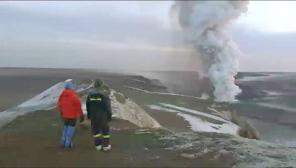 A plume of smoke rises from the Grimsvotn volcano in Iceland on Wednesday in this image from television. Volcano experts in Iceland said the eruption which began Saturday appeared to be tapering off. Ash from the volcano forced the cancellation of hundreds of flights over Britain on Tuesday as winds blew the ash over Scotland, but British airspace was clear Wednesday. German air traffic control banned all takeoffs and landings at airports in Berlin, Bremen, Hamburg and Luebeck for several hours early Wednesday.