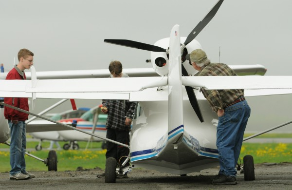 Matt Hikel, left of Kenduskeag, Tristen Wright, center, of Corinth, and Bruce Shirland, right, of Old Town inspect a Sea Max ,100 horse power, two seater light sport aircraft at the Old Town Municipal Airport on Saturday, May 21, 2011 during International Learn to Fly Day sponsored by the Penobscot Valley Chapter 827 of the Experimental Aircraft Association.