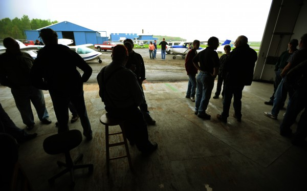 Airplane enthusiast sit in a hangar and talk aviation as rain falls at the Old Town Municipal Airport on Saturday, May 21, 2011 during International Learn to Fly Day sponsored by the Penobscot Valley Chapter 827 of the Experimental Aircraft Association.