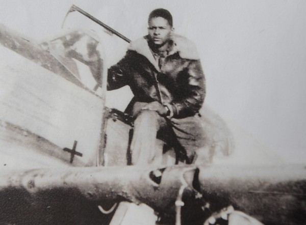 Tuskegee Airman James A. Sheppard with his plane during WWII.