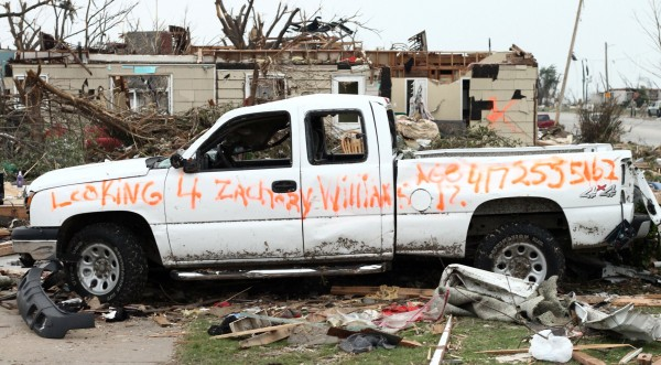 This Tuesday, May 24, 2011, photo shows a message painted on the side of a truck damaged in the Joplin, Mo., tornado asking for help finding Zachary Williams, 12. As hours stretched to days after a tornado plowed into Joplin and killed more than 120 people, the search by survivors for loved ones took turns both heartbreaking and heartwarming as the those missing in the debris were found both alive and dead.
