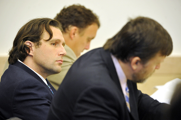 Seated next to one of his defense attorneys, Peter Cyr and Richard Hartley right, Colin Koehler (left), listened to Assistant Attorney General Andrew Benson (not pictured) deliver the prosecution's closing argument in Koehler's trial at Penobscot Judicial Center in Oct. 2010.
