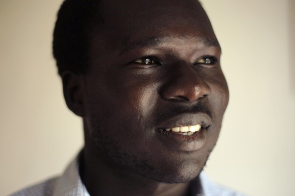 Aruna Kenyi poses at his home, in Portland on Thursday, May 19. It has been 16 years since Kenyi fled his small remote village in terror when it was attacked and torched by the militia during the Sudanese Civil War.