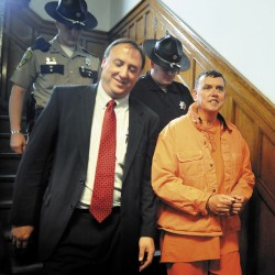 Maine state Rep. Frederick Wintle, R-Garland, right, is escorted back to Kennebec County jail on Monday, May 23, 2011 by Maine House Republicans Chief of Staff Earl Bierman, left, and two deputies following Wintle's Harnish hearing at Kennebec County Superior Court in Augusta, Maine. Wintle is being held after allegedly pointing a gun at a man Saturday in Waterville.