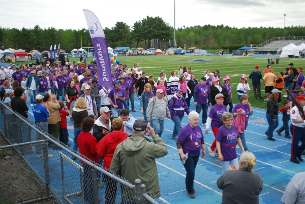 Cancer survivors and caregivers walk the first lap of the American Cancer Society's Relay for Life of Penobscot County on Friday, May 20.