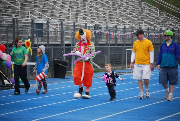 Tempo the Clown prepares balloon animals for people walking the track during the American Cancer Society's Relay for Life of Penobscot County at the University of Maine in Orono on Friday, May 20.