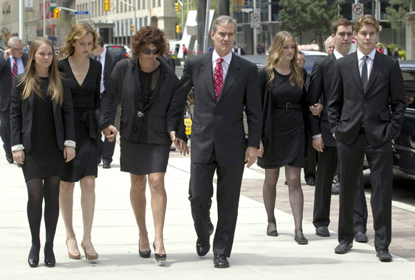 Michael McCain, center, and his family arrive for the funeral of his father Wallace McCain in Toronto on Friday May 20, 2011.   McCain, a billionaire frozen food mogul and philanthropist  helped turn a small Canadian french fry plant into the global McCain Foods empire.   He was 81.