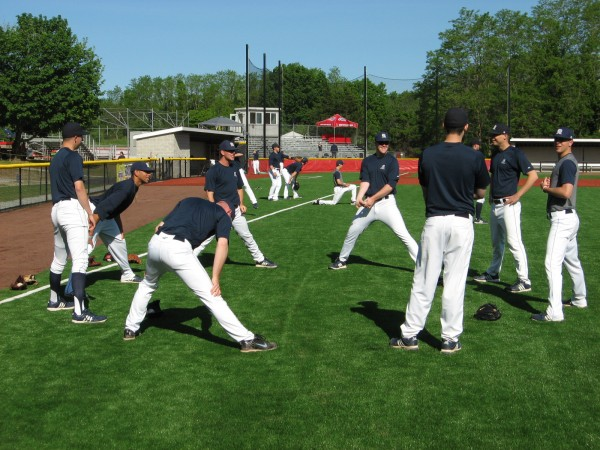 Members of the UMaine pitching staff go through their stretching routine Wednesday prior to the Black Bears' America East baseball tournament game against Binghamton in Stony Brook, N.Y.