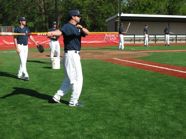 UMaine senior co-captain Joe Miller hits fungos during infield practice prior to Wednesday's America East baseball tournament game in Stony Brook, N.Y.